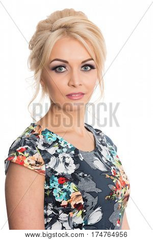Portrait of a beautiful girl in a flowered dress isolated on white