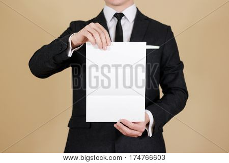 Man Showing Blank Black Flyer Brochure Booklet. Leaflet Presentation. Pamphlet Hold Hands. Man Show