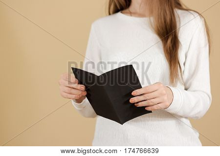 Girl Reading Blank Black Flyer Brochure Booklet. Leaflet Presentation. Pamphlet Hold Hands. Woman Sh