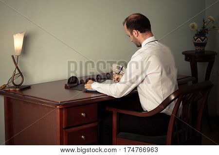 young business man working at table in office