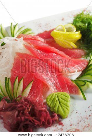 Tuna Sashimi - Sliced Raw Tuna on Daikon (White Radish) with Seaweed and Cucumber