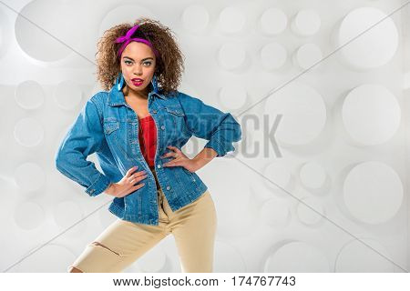 Serene african woman with bright look posing in colorful clothes. Copy space