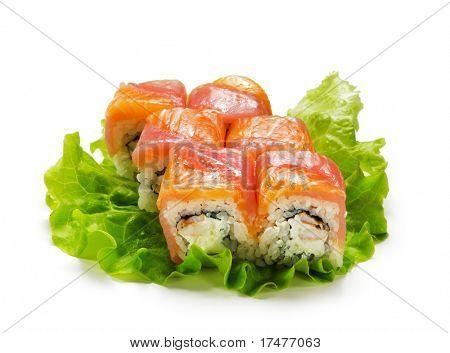 Salmon and Tuna Maki Sushi - Roll made of Cream Cheese and Shrimp (ebi) inside. Fresh Salmon and Tuna outside. Served on Salad Leaf