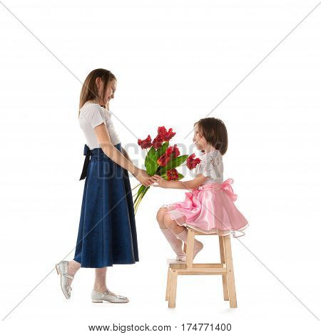 Two Little Girls With Flowers