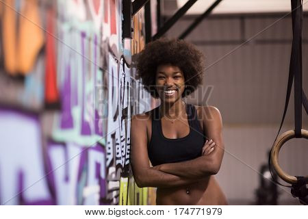 Fitness dip ring african american young woman relaxed after workout at gym dipping exercise