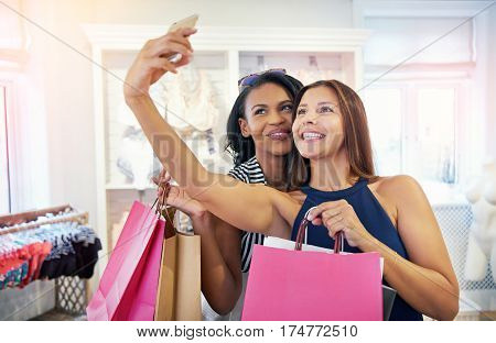 Stylish Young Female Shoppers Taking A Selfie
