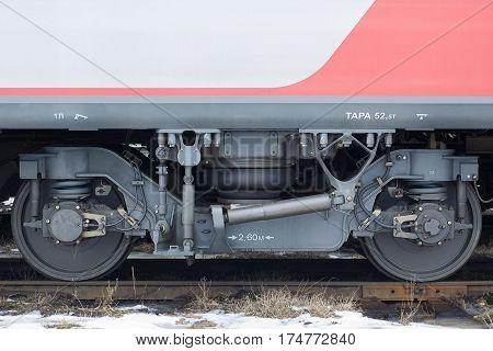 Wagon wheels on the train tracks closeup