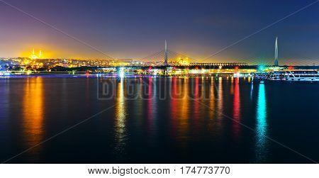 Night view of the Gold Horn Metro bridge. Panorama of the two shores of the Bosphorus Strait. Istanbul bridge at night Turkey
