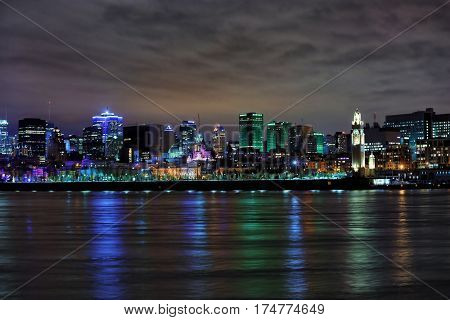Beautiful view of downtown Montreal during evening in reflection in St Lawrence river in Montreal, Canada