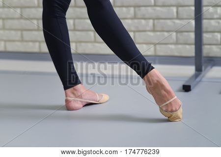Detail of ballet dancers feet, close up of pointe shoes.