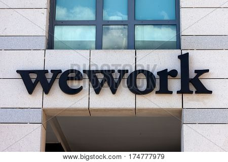Tel Aviv, Israel - March 4, 2017: WeWork sign. WeWork is an American company which provides shared workspace, community, and services for entrepreneurs, freelancers, startups and small businesses.