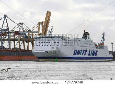 SWINOUJSCIE POLAND - FEBRUARY 21 2017: A car ferry from Unity Line departing from the harbor for a journey across the baltic sea.