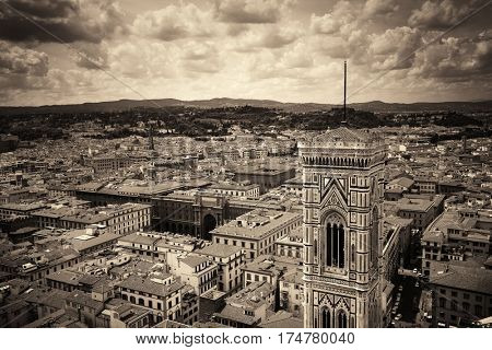 Duomo Santa Maria Del Fiore bell tower and city skyline in Florence Italy black and white.