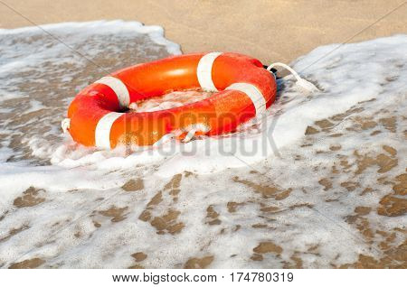 Lifebuoy on the sea shore close up
