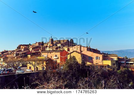 Military aircraft flying over the Roussillon village. One of the most impressive villages in France