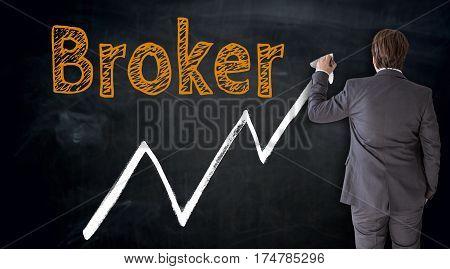 Businessman writes Broker on blackboard concept picture