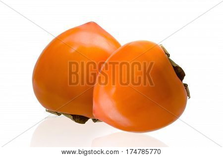 Pair of ripe persimmon fruits isolated on white background. Two whole persimmons with. Clipping path