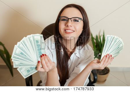 Business woman with money fans in hands