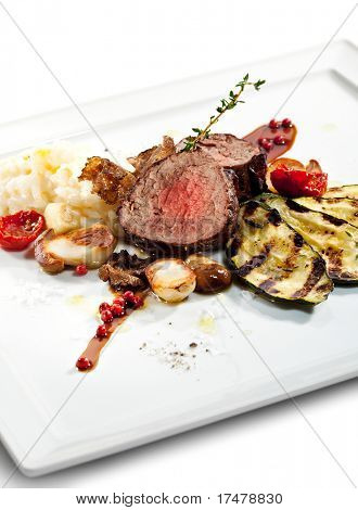 Prime Veal with Risotto, Tartufo Nero (Black Truffle), Zucchini Grill, Porcini and Dried Tomato poster