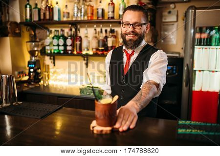 Barkeeper show attractive alcohol cocktail