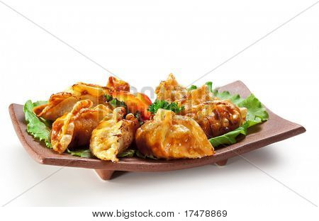 Japanese Cuisine - Pork (or Seafood) Dumplings (gyoza). Garnished on Salad Leaf with Pepper and Fresh Parsley poster