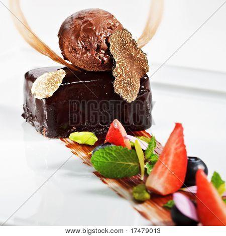 Ganache Dessert - Sweet mixture of Chocolate and Heavy Cream. Garnished with Tartufo Bianco (white truffle mushroom), Fresh Mint Leaf and Berries