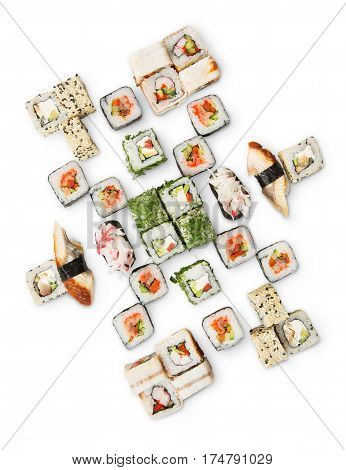 Japanese food restaurant delivery - sushi maki, unagi and california roll big party platter set isolated on white background, top view, vertical