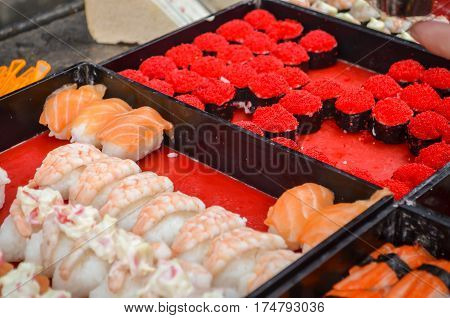 Assorted of fresh sushi at street food in Thailand.