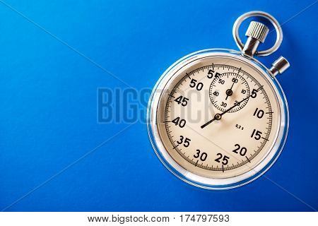 Stopwatch on the blue background in closeup