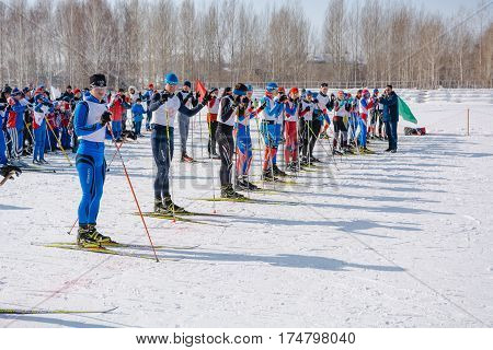 Altai Krai RUSSIA - March 05 2017: the race Health Ski Track ski climbers rise on skis by a grief. Asian of mountain skiing of the Command race Russian Altai Championship.