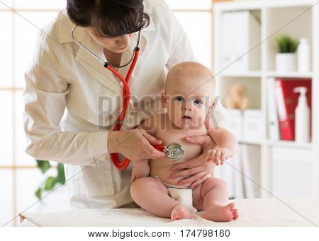 pediatrician doctor with baby kid in medical room