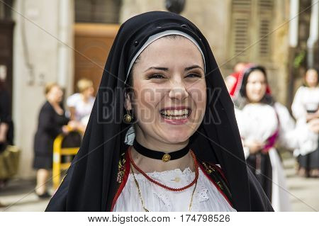 CAGLIARI, ITALY - May 1, 2013: 357 Religious Procession of Sant'Efisio - portrait of a beautiful smiling girl in traditional Sardinian costume - Sardinia