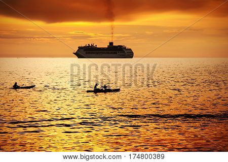 Seascape with boat and colorful of sunset in twilight