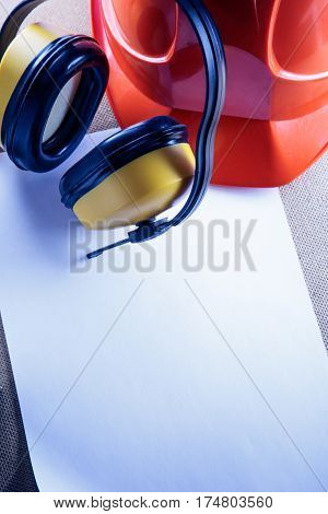 Helmet, Earphones And Blank Sheet Of Paper