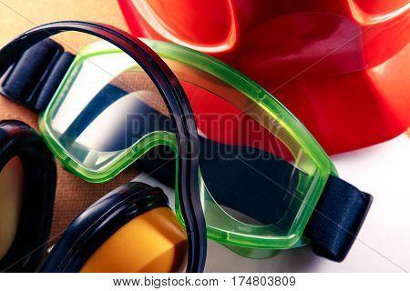 Helmet, Earphones, Goggles And Blank Paper