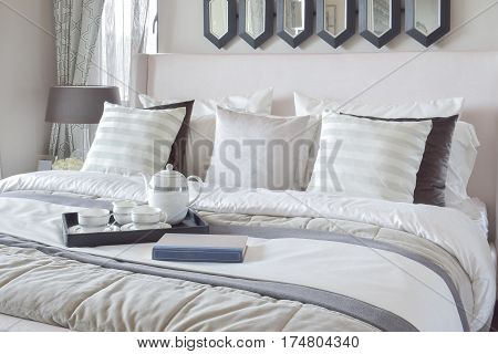 Decorative Tray With Book And Tea Set On The Bed In Modern Bedroom