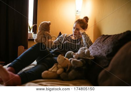 Playing With Her Bear