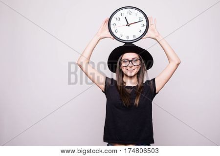 girl with the clock over head on grey background