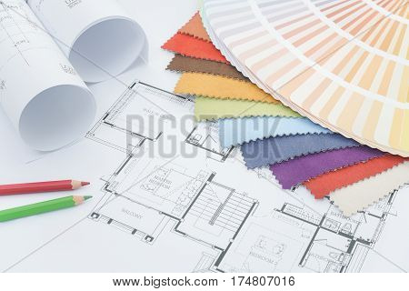 Interior Designer Working Dask With Drawing, Fabric Sample, Color Pencil And Color Pallette