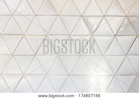 Triangle shaped ceramic tiles wall texture background
