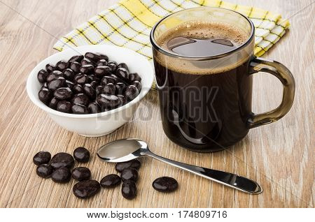 Dragee Raisins In Cacao, Coffee Cup, Spoon And Checkered Napkin