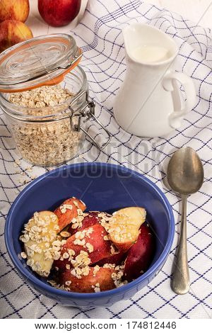 healthy breakfast with oatmeal scottish buttermilk and apple pieces in a blue bowl