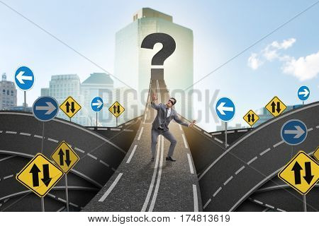 Blindfold businessman on the road unsure