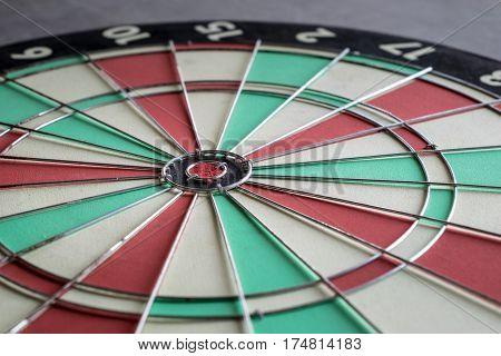 close up bullseye on dartboard challenge target marketing background concept.