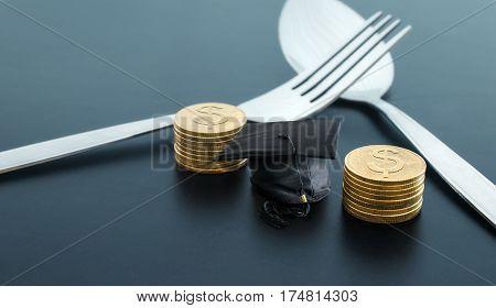 fork congratulations graduates cap and money on dark board scholarship money background concept.