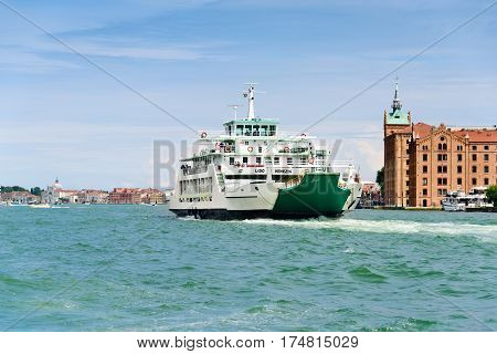 Venice Italy - June 14 2016: The Lido Di Venizia a car ferry that transports cars motorcycles bicylces and foot passengers from the resort island to Venice.