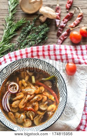 Bowl Of Thai Tom Yum Soup On The Wooden Background