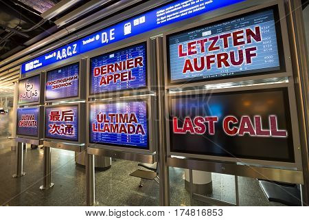 In airport departure board displays the last call in English, german, french, arabic, russian, chinese, spanish, italian