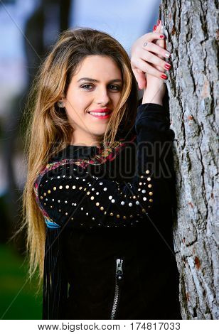 Portrait of beautiful blond woman in the park