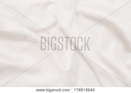 Crumpled white fabric material texture for background